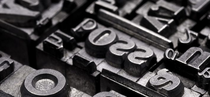 Metal Letterpress Types.A background from many historic typographical letters in black and white with white background.