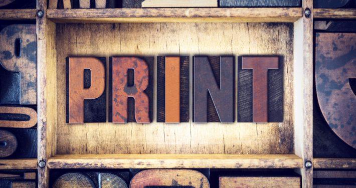 """The word """"Print"""" written in vintage wooden letterpress type."""